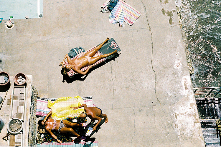 Colour 35mm frame of people sun baking taken from above in Marseille, France.