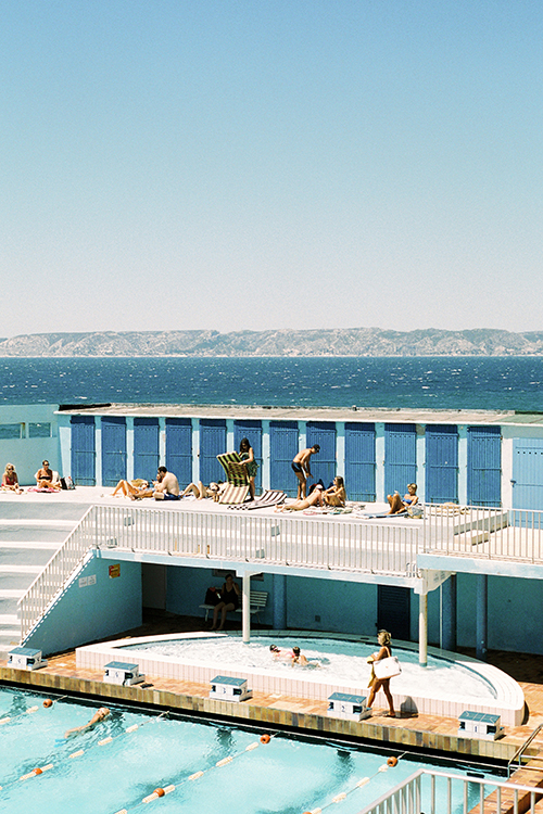 Colour 35mm frame of pool scene at CN Marseille, France with Mediterranean in the background.
